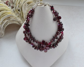 Dainty Burgundy Red Stone Multi Strand Bracelet Knotted on Silk with Garnets. Swarovski Crystals and Sterling Silver