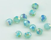 Twelve Swarovski crystals in the non-standard finish AB 2X - Art. 5000 - 8 mm - pacific opal AB 2X