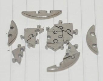 Coin cut puzzle. 13 pcs. 1 french franc