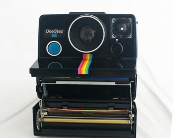 Camera - Polaroid OneStep SE Polaroid Land Camera 80's with attached strap