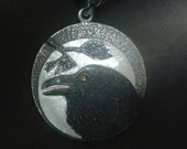 Raven on a Full Moon Night in Pine Tree Sterling Silver with Orange Sapphire Eye -  Feather on Reverse side Shield Pendant