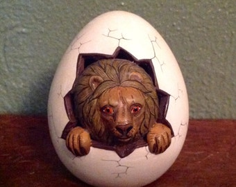 Vintage ceramic egg with emerging lion signed Xochipilli Mexico