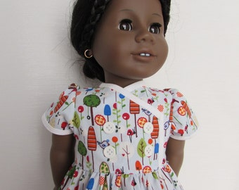 "Cute dress in a fun garden print for your 18"" American Girl dolls"