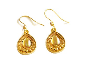 Avon teardrop earrings, aurora borealis (AB) cabochons inside a frame of goldtone raised dots, french hooks ending with an amber rhinestone