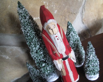 Wooden Hand Carved and Painted Father Christmas, Wood Santa, Red and Green, Bearded and Hooded, with gift pouch and tree on  back