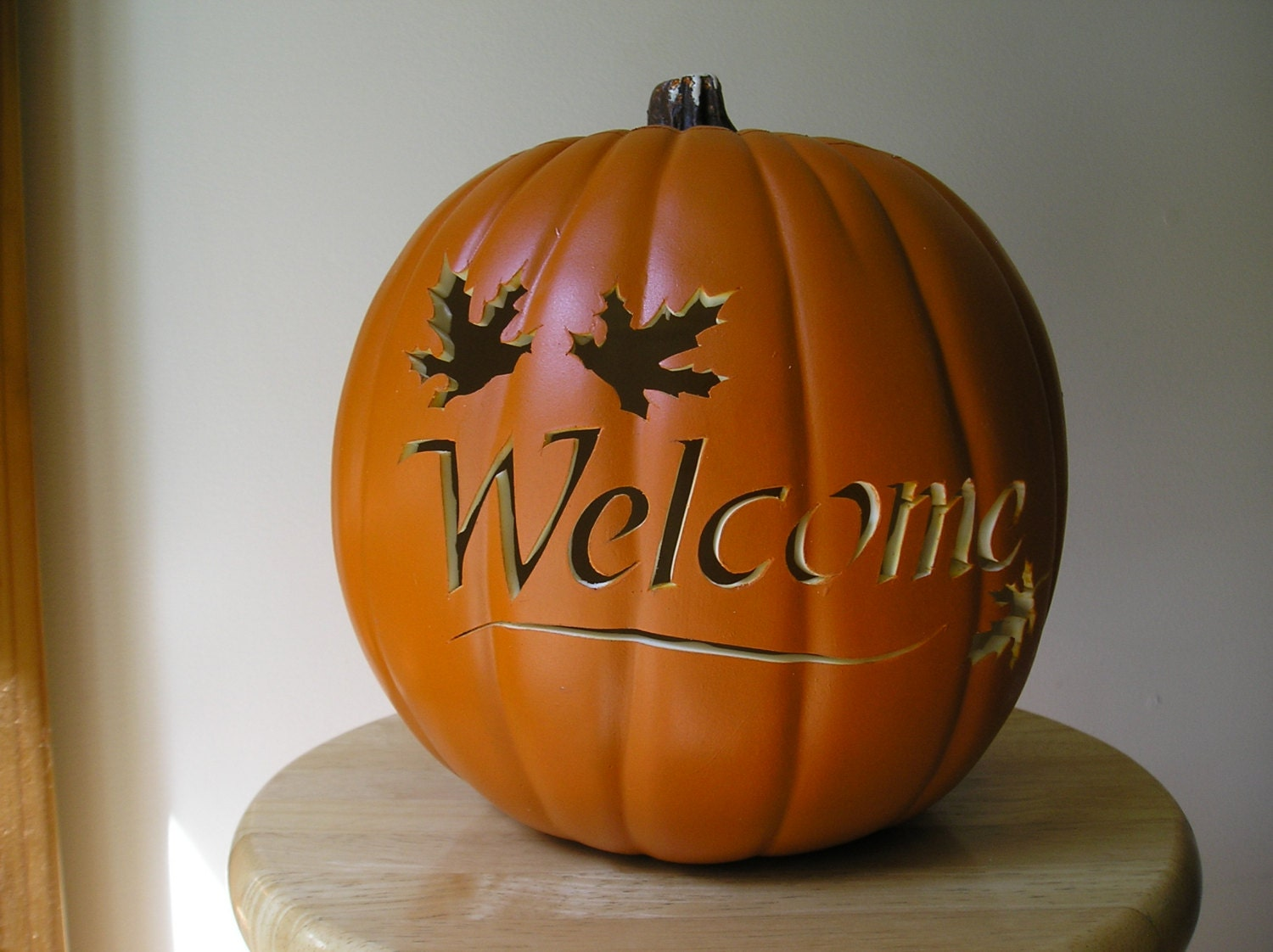 Carved welcome orange pumpkin with maple by purpleinkgraphics