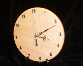 Clock, Curly Mape, can hang on a wall or comes with stand