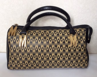 Vintage MOSCHINO black and ivory beige logo M print handbag, mini duffle bag with leather trimmings and golden M charms.