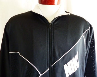 vintage 80's Nike black full zip track jacket white stripe piping black diagonal asymmetric mesh white block letter logo stand collar large