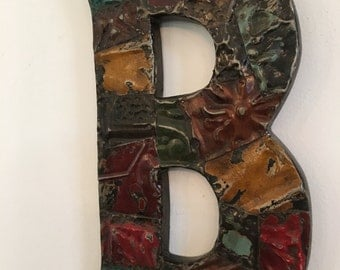 """Patchwork letter """"B"""" designed with antique tin ceiling tile"""