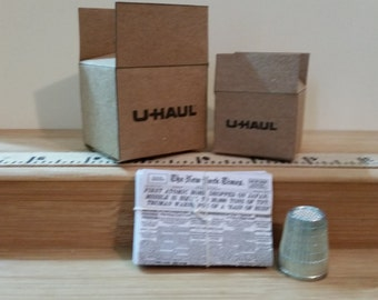 BC-1     U-haul Miniature boxes  2  ( lg - sm sizes)  see ruler for size& stack of newspapers