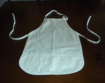 child toddler apron natural muslin cobbler pocket USA innovo