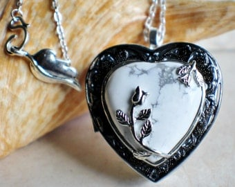 White turquoise heart music box locket, heart shaped locket with music box inside, in silver tone with white turquoise heart stone heart.