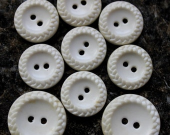 vintage white plastic buttons. set of 9 braided edge 2 holes-2 @ 3/4 inch=7 @ 5/8 inch 1950's sewing notions