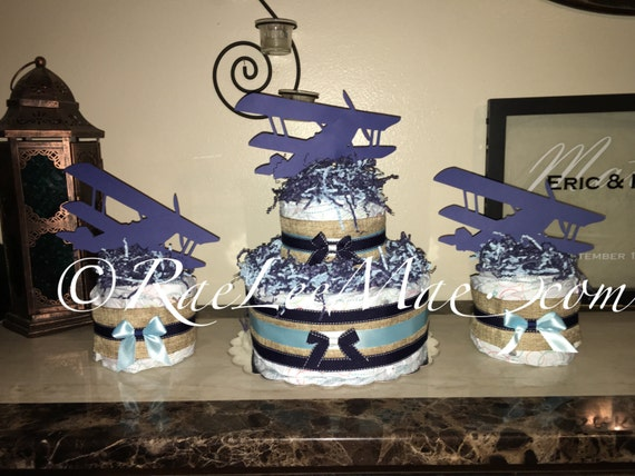 Old airplane diaper cake old airplane baby shower decorations for Airplane baby shower decoration ideas