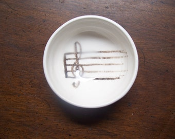 music staff in a little bowl
