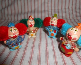 Four Mini Clown figures Made From A child's Marbles