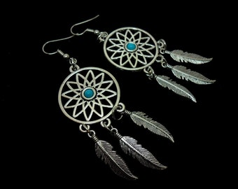 A pair of  long dangly dreamcatcher earrings. new.