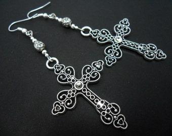 A pair of long tibetan silver cross dangly earrings.