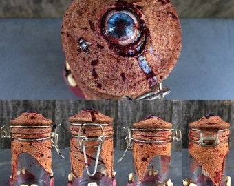 Human Flesh Jar size small. w/ blue eye