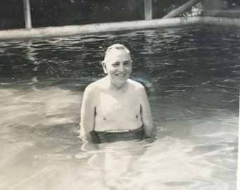 vintage black and white photo of old man sitting in pool