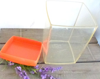 plastic container with orange top- for the retro kitchen