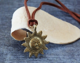 Small brass sun pendant with chain