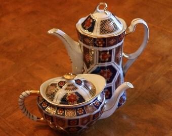Imari Style Pattern Coffee and Tea Set: Coffee Pot, Tea Pot, Creamer, Sugar Bowl, Four Teacups, and Four Saucers