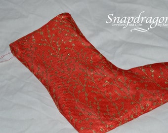 Red linen Christmas stocking with gold glitter pattern, fully lined.