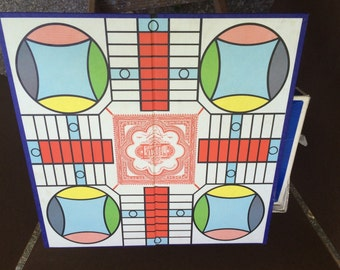 Parcheesi board and box.