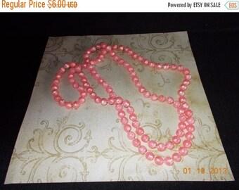 sale vintage plastic pink string necklace....79