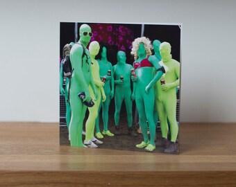 Lycra men - a group of green lycra covered revellers at Glastonbury music festival
