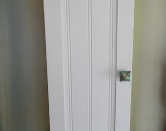 WALL STORAGE CABINET     White... Unique Knob...Slim design for difficult walls....Adjustable shelves.....Handmade...Branded by cabinetmaker