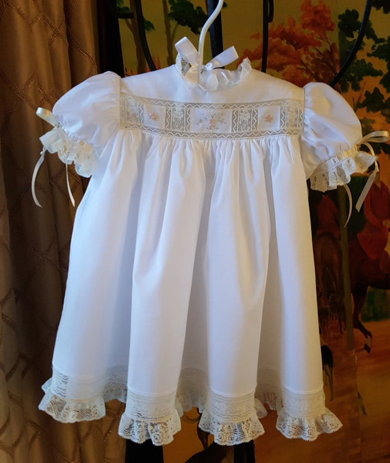 Three sectioned hand embroidered yoke baby dress with french