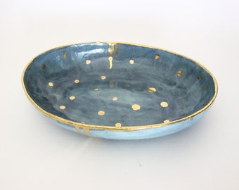 Handmade blue ceramic bowl with 22K gold luster accents