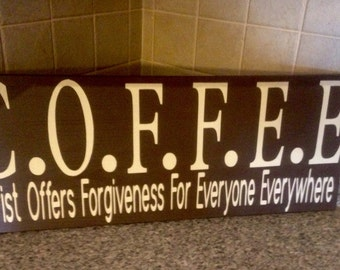 Coffee, christ offers forgiveness for everyone everywhere,wooden sign