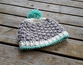 Textured crochet hat with pom pom