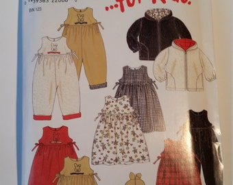 New Look ...for kids Sewing Pattern 6796 Girls' Dress, Jacket, Romper and Hat in Size 1/2, 1, 2, 3, 4