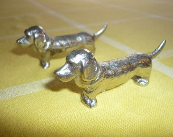 Two French dog cutlery/knife rests