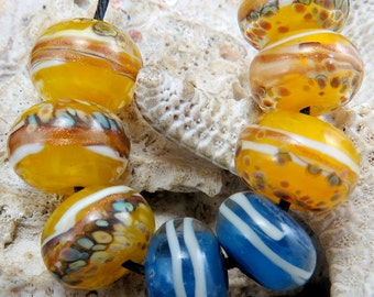"Lampworked beads.   "" CANARIES '"