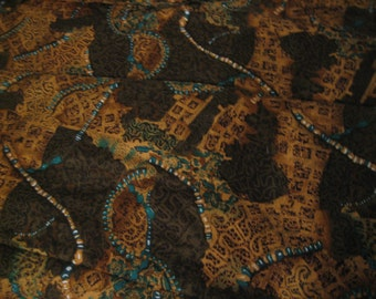 """Retro 90's rayon woven fabric @ 58"""" wide in browns golds and turquoise. Sold by-by-the-half-yard."""
