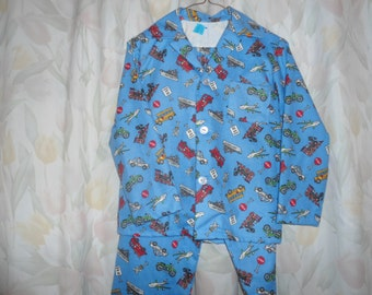 Size 12 Boys Pajamas w/ fire trucks, ships, trains, buses, planes, police cars, etc. on blue