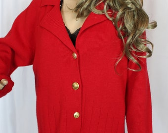 Red sweater with gold buttons