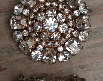 two vintage rhinestone brooches
