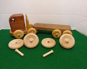 "Wooden Toy Wheels and Axle Pegs (4) 2 3/4"" Wheels and (4) Axle Pegs"