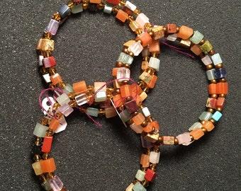 Multi color gemstone memory wire bracelets.