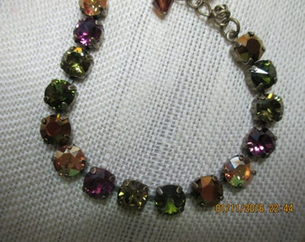 8M Jewel Tone Swarovski Bracelet Antique Brass Setting 7 in long with a 1.5 ext & a crystals at the end