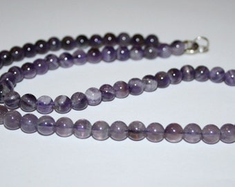 6 mm round smooth amethyst beads.