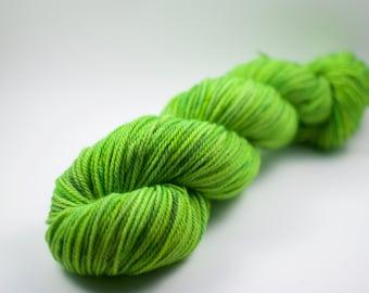 "DK Yarn - UV-Reactive - 218 yards - ""Nuclear Spill"" Kettle Dyed Yarn - 100g Merino Wool"
