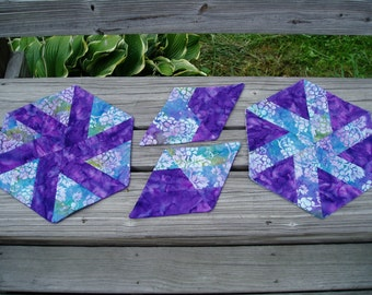 Hand Quilted Batik Hexagon place mats and mug rugs in a rich purple and colorful floral